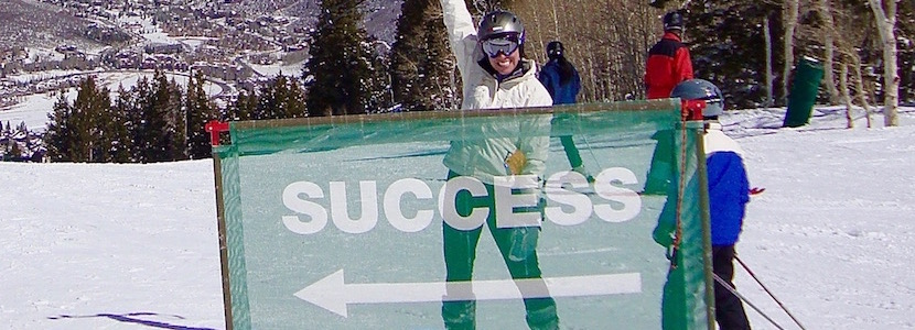 "ski run sign that says ""success"""