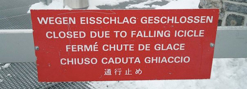 """closed due to falling icicle"" sign in multiple languages"
