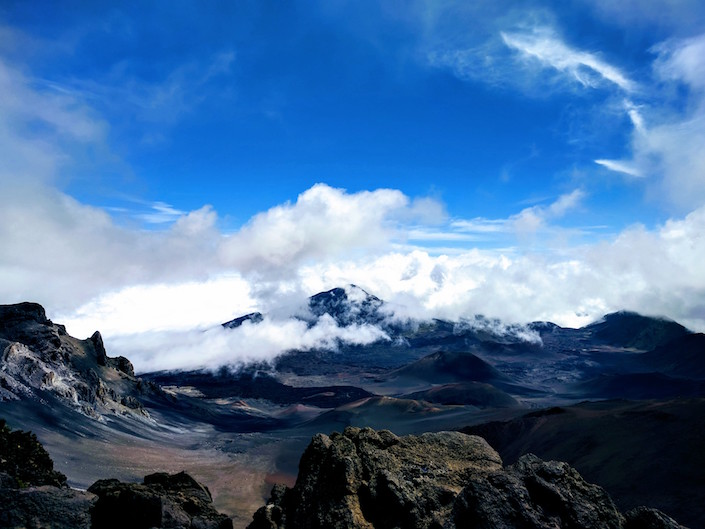 Volcanic mountains/craters and clouds.