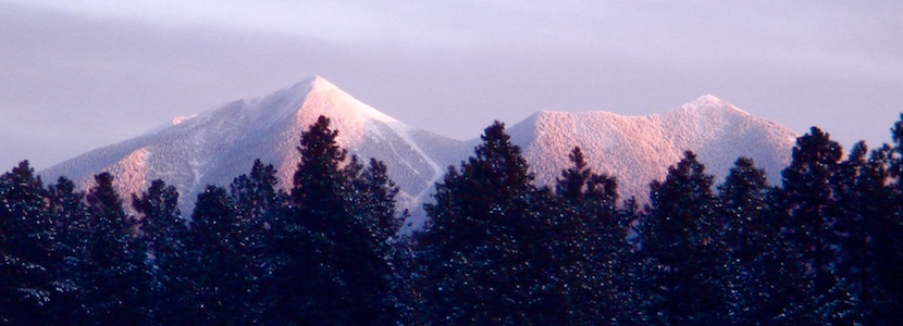 sunrise on snowy mountians