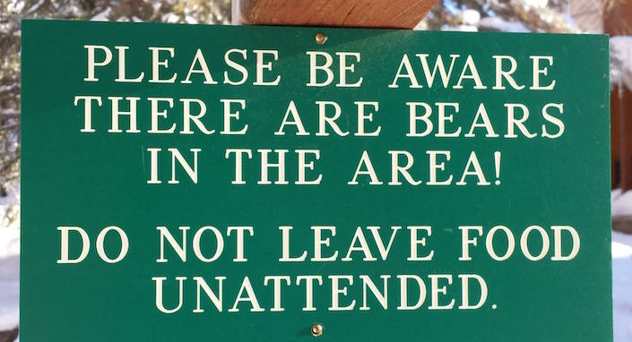 "Sign: ""please be aware there are bears in the area. Do not leave food unattended."""