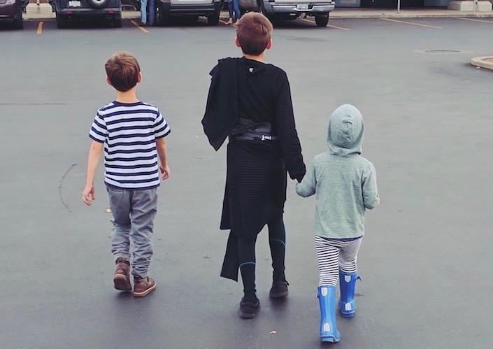 three boys walking in parking lot