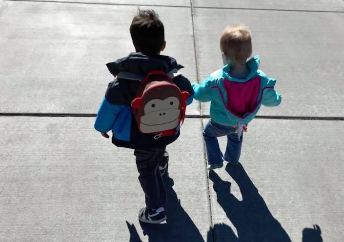 Two kids walking