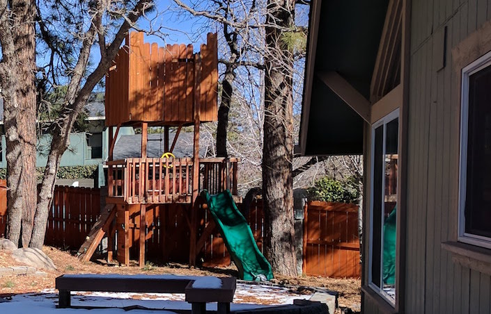 """tree fort"" type play structure in back yard"