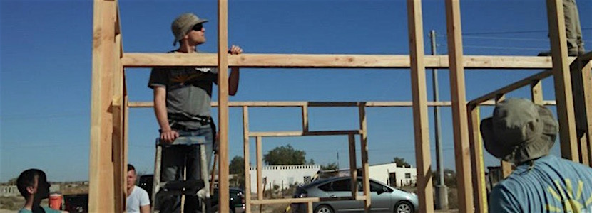 men working on framing a house