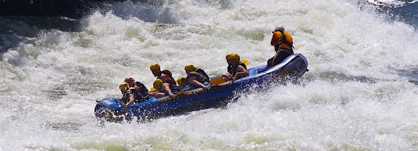 rafters going through whitewater