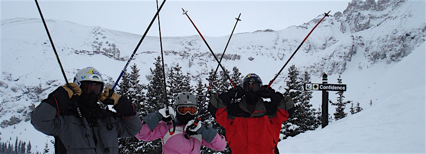 "Three skiers with a black diamond sign that says ""confidence"""
