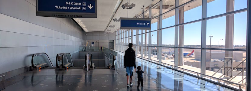 boys walking in empty airport hall