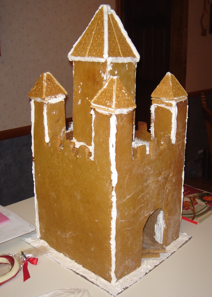 Gingerbread castle held together with frosting with no decor