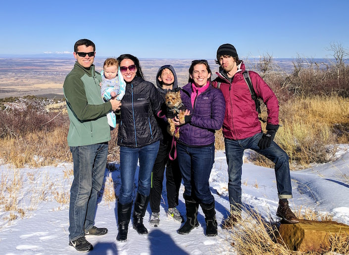 group of friends with kids, puppy on high mesa