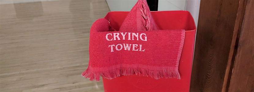 "Red towel that says ""crying towel"" on it"